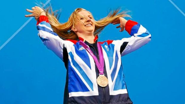 Britain's Rebecca Adlington tosses her hair back as she poses with her 400m freestyle medal. Its colour was bronze ...