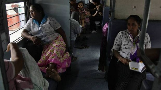 Passengers sit in a train as they wait for electricity to be restored.