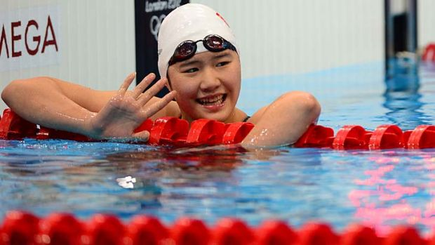 Golden grin ... but the stunning times of China's Ye Shiwen have aroused suspicion.