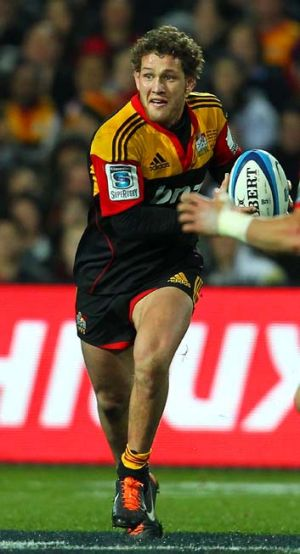 Tawera Kerr-Barlow looks to pass during the Super Rugby semi-final against the Crusaders.