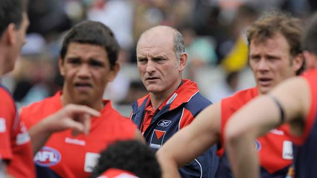Melbourne coach Dean Bailey with his team at quarter time during the round 18 clash against Richmond in 2009. Melbourne ...