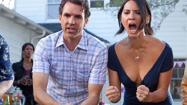 Paul Schneider and Olivia Munn in a scene from <i>The Babymakers</i>.