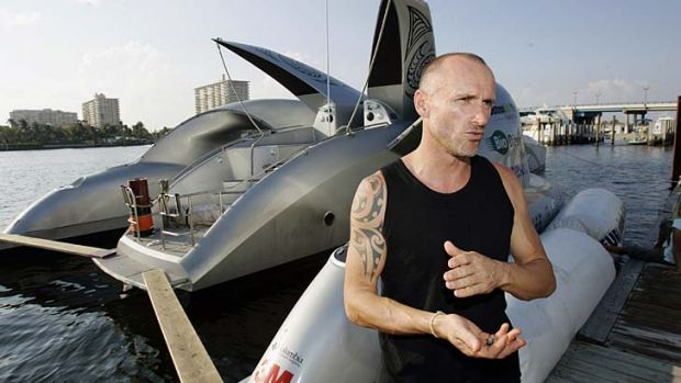 Pete Bethune stands next to the ship that was to be renamed the Ady Gil, in Fort Lauderdale, Florida, in 2006.
