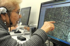 I think that's my house: Methiye Nuka, 71, surfs the internet at Brunswick's Neighbourhood House, helped by the NBN's ...