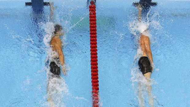 Nothing in it ... Nathan Adrian, left,  touches one hundreth of a second ahead of James Magnussen.