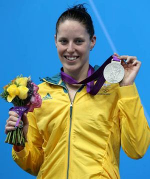 Alicia Coutts shows off one of her silver medals.