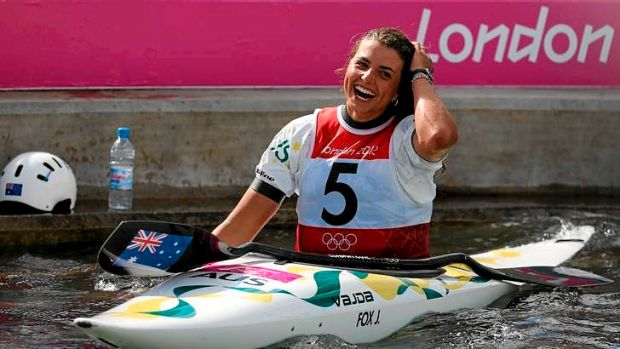 Australia's Jessica Fox celebrates her K1 canoe slalom silver medal on the course at the Lee Valley White Water Centre.