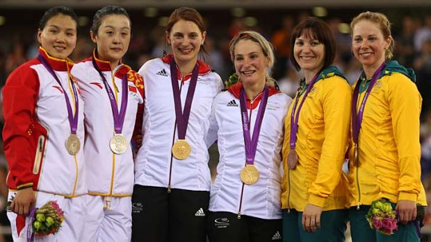 Anna Meares, fifth right, and Kaarle McCulloch, far right, show off their bronze medals. The Chinese pair, left, were ...