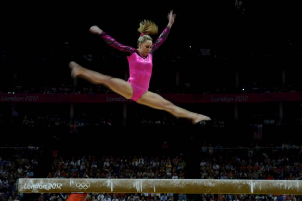 Australian gymnast Emily Little  in action on the beam during the final of the individual all-around.
