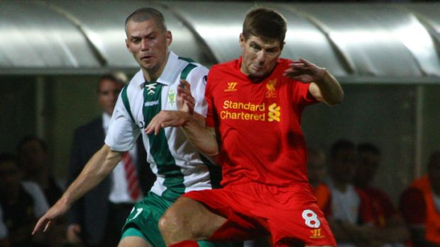 Liverpool's Steven Gerrard (right) vies for the ball with Gomel's Artur Liatvinski during their Europa League qualifying ...