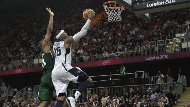USA's Carmelo Anthony drives to the basket past Nigeria's Derrick Obasohan.