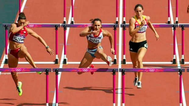Jessica Ennis (centre) runs the fastest ever heptathlon 100 metre hurdles on day one of the ahletics at the Olympic ...