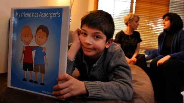 Turning his world around: Robert, 9, who has Asperger's syndrome, with (back centre) author Amanda Curtis and his ...