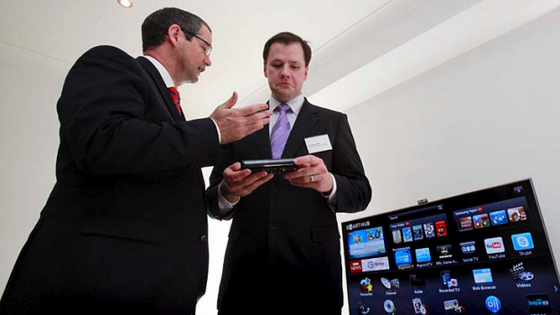 Hiked tech prices for Australia ... federal MP Ed Husic, right, with Senator Stephen Conroy.