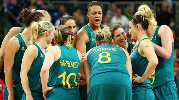 Standing tall ... the Opals celebrate after defeating Russia.