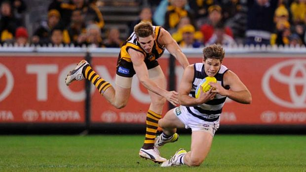 Geelong's Tom Hawkins marks with moments to go in front of Hawthorn's Ryan Schoenmakers.
