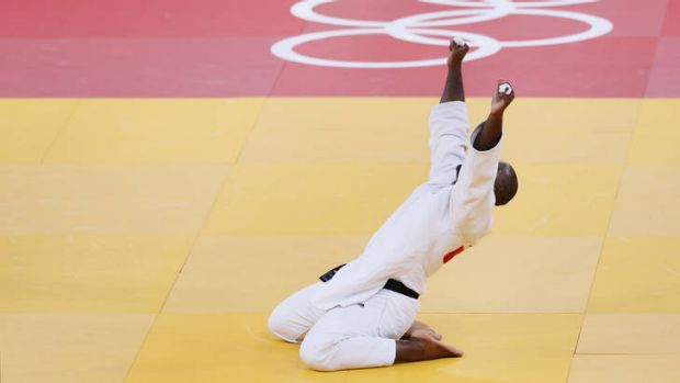 France's Teddy Riner celebrates after winning the men's judo heavyweight final.