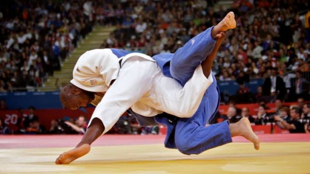 In competition ... Teddy Riner of France versus Faicel Jaballah of Tunisia in the 100kg plus heavyweight division of the ...