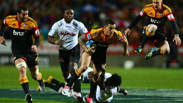 Star turn ... Sonny Bill Williams of the Chiefs breaks the tackle of Lwazi Mvovo of the Sharks.