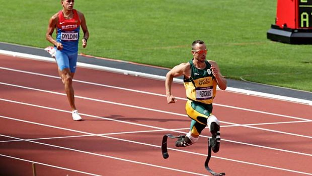 Crowd favourite ... Oscar Pistorius finishes comfortably second in the opening heat of the 400 metres,