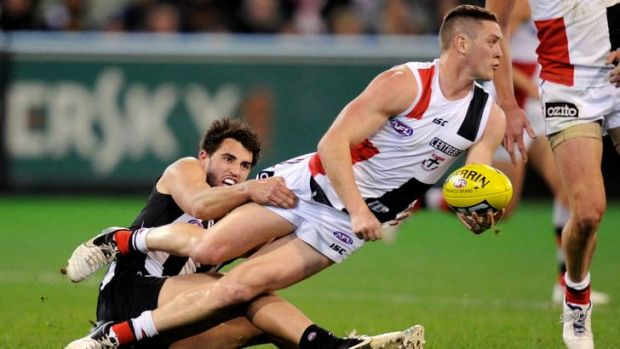 St Kilda's Jack Steven is tackled by Magpie Alex Fasolo last night..