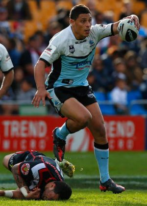 Defenceless ... Anthony Tupou of the Sharks skips away from the Warriors.