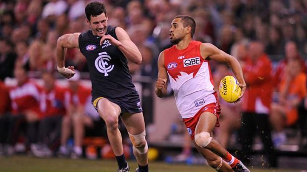 Speed machine: Lewis Jetta clears away from Simon White yesterday.