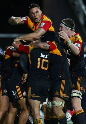 Head and shoulders ... NRL-bound Sonny Bill Williams celebrates with the victorious Chiefs.