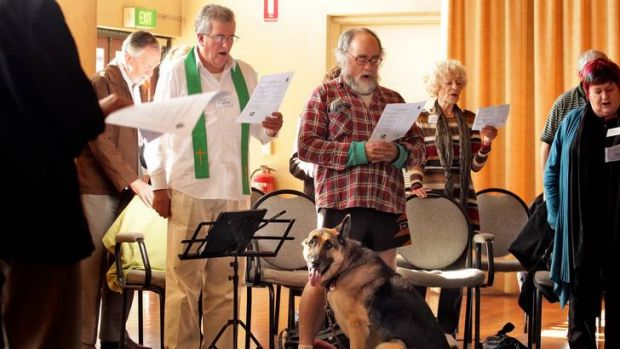 All creatures great and small: Father Greg Reynolds leads Mass at the Inclusive Catholics service in South Yarra, where ...