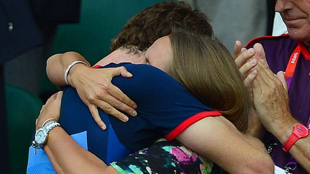 Winner ... Andy Murray hugs girlfriend Kim Sears.