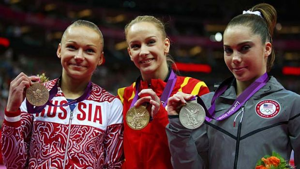 Silver medallist McKayla Maroney, right, stands with gold medallist Sandra Raluca Izbasa, centre, of Romania and bronze ...