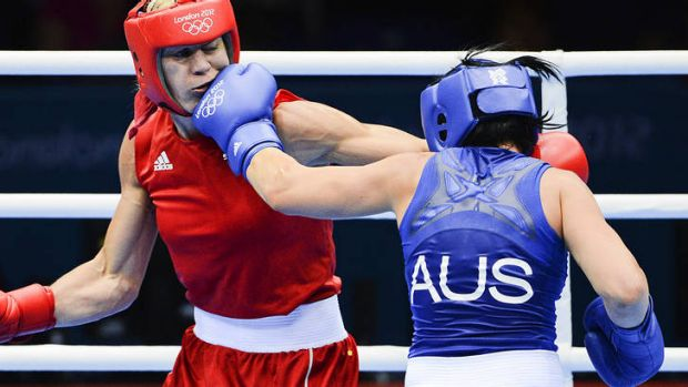 No holding back ... Australia's Naomi-Lee Fischer-Rasmussen scores with a left jab against Sweden's Anna Laurell in ...