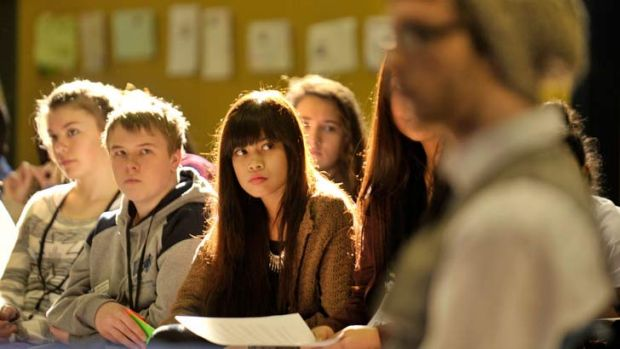 Students Lily Downs, from left, Jake Kearns and Sufi Salieh take in the debate of policy at the Victorian Student ...