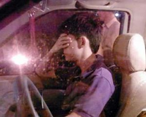 In the driver's seat ... Hu Bin is seen in his car immediately after the accident.