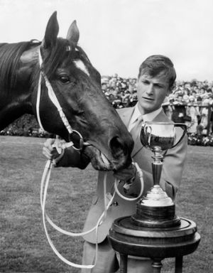 Les Samba, then working as a strapper, with Rain Lover after winning the 1969 Melbourne Cup.