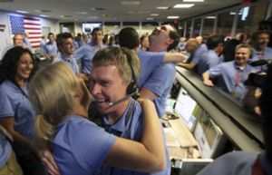 Members of the NASA team celebrate the successful landing on Mars.