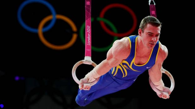 Rings of truth ... the concentration is written on Zanetti's face as he hangs perfectly still during his gold ...