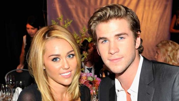 Happier days: Miley Cyrus and Liam Hemsworth.