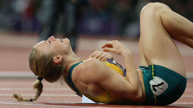Overcome with emotion ... Australia's Sally Pearson wins gold.