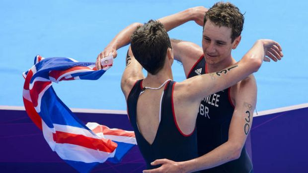 The Brownlee brothers congratulate each other after finishing the triathlon.