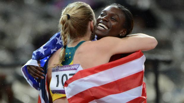 Sally Pearson and Dawn Harper congratulate each other.