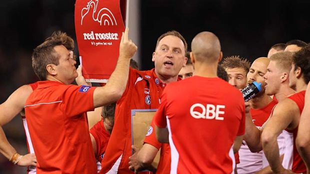 John Longmire and the Swans have adjusted and today are perched atop the AFL ladder, a game clear of their rivals.
