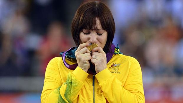 Golden girl ...Australia's Anna Meares kisses her gold medal on the podium after winning the women's sprint final.