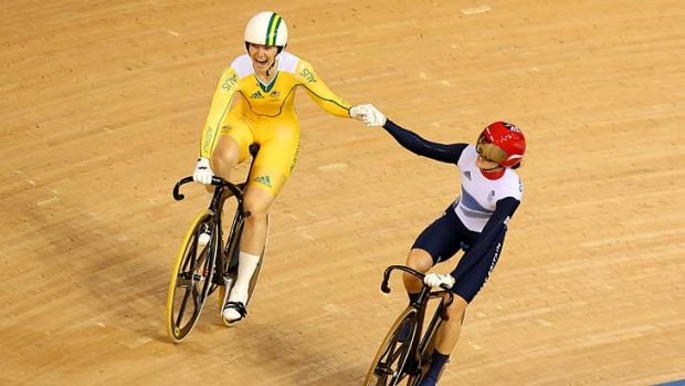 Magic moment ... Britain's Victoria Pendleton raises the arm of Anna Meares after the Australian's gold medal win at the ...