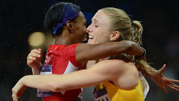 Respect ... Australia's Sally Pearson is congratulated by Kellie Wells.