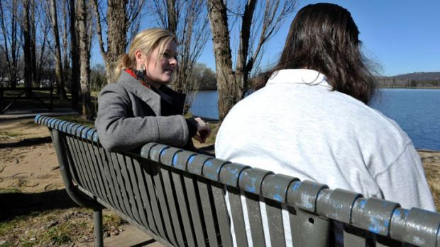 On the outer ... health worker Jean Fitzroy chats with Charles on a seat by Lake Burley Griffin. The once homeless man ...