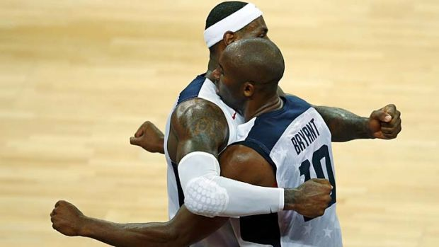 Through to the semis ... Lebron James, left, and Kobe Bryant celebrate victory.