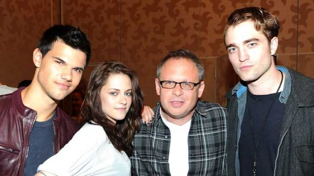 Team work: From left, <i>Breaking Dawn</i>'s Taylor Lautner, Kristen Stewart, director Bill Condon and Robert Pattinson.
