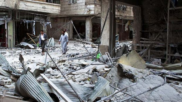 The aftermath ... residents of the Salaheddin district in the northern Syrian city of Aleppo walk past destroyed ...