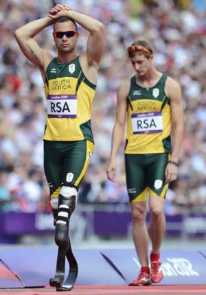 He's back ... Oscar Pistorius (left) will get another chance to run at the Olympic Games.